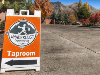 Taproom sign for Wanderlust Brewing Company a brewery in flagstaff arizona